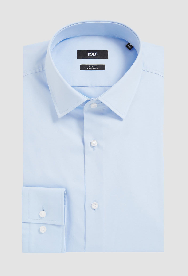 the Hugo Boss slim fit jenno business shirt in blue cotton poplin folded on a grey background