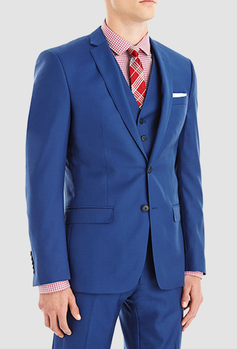 a model faces the side wearing the Gibson slim fit lithium suit in blue pure wool FGY007 styled with pink and red shirt and tie