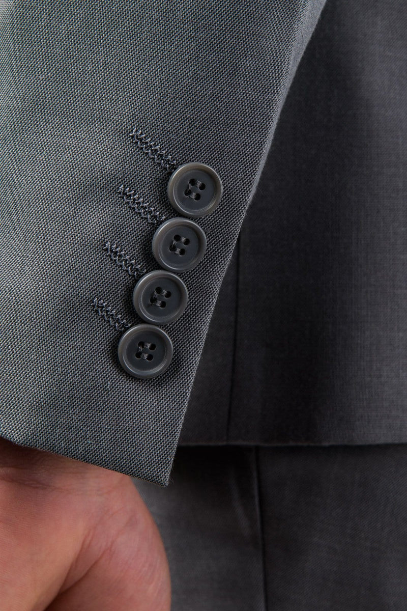 A close up of four grey buttons on the sleeve detailing of the Aston slim fit laneport suit in grey A039301S