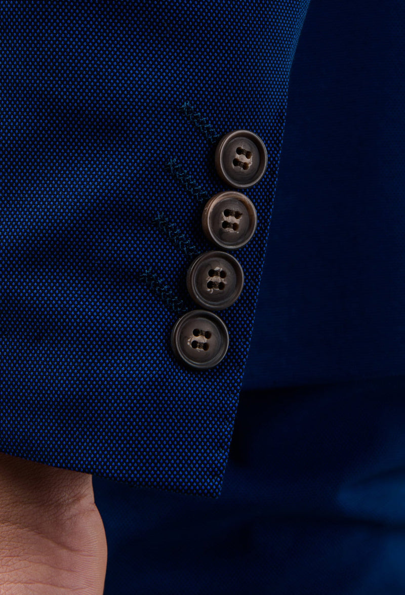 a close up view of the sleeve button details of the Aston slim fit leon suit in blue A042718S
