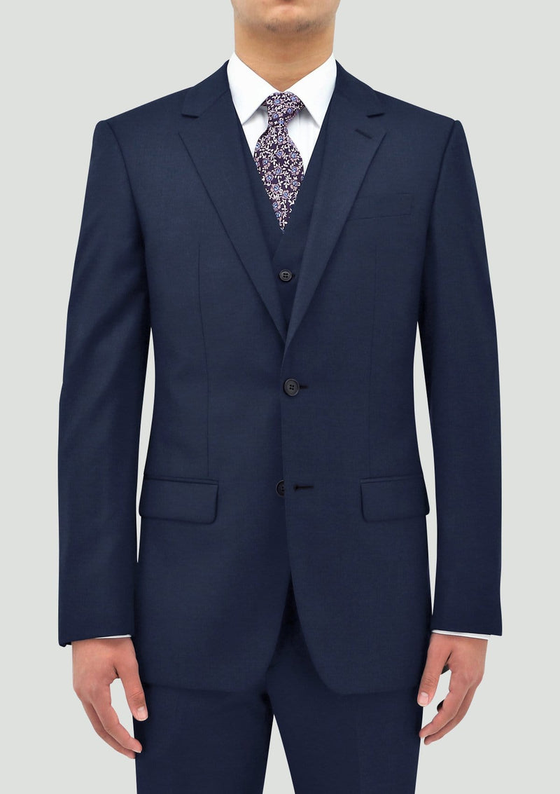 the Daniel Hechter slim fit ryan vest in blue pure wool layered under the shape suit jacket DH106-15