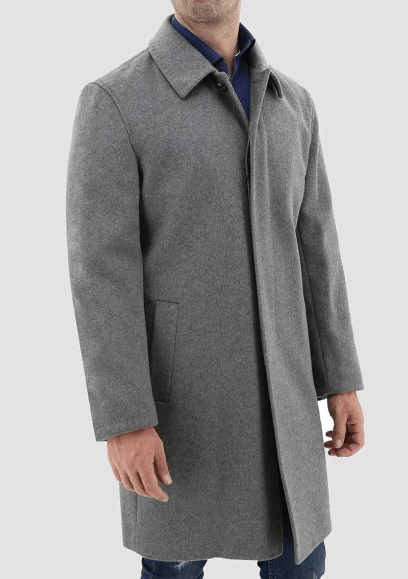 a man wearing a casual weekend look featuring the Daniel Hechter carvell grey cloak winter overcoat  over a navy shirt and blue jeans