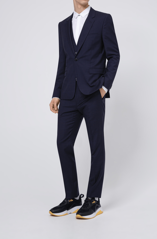 the full length view of the hugo boss mens arti hesten suit jacket in dark navy pure wool a flatlay image of the slim fit arti hesten hugo boss suit trouser in blue pure wool 50427352
