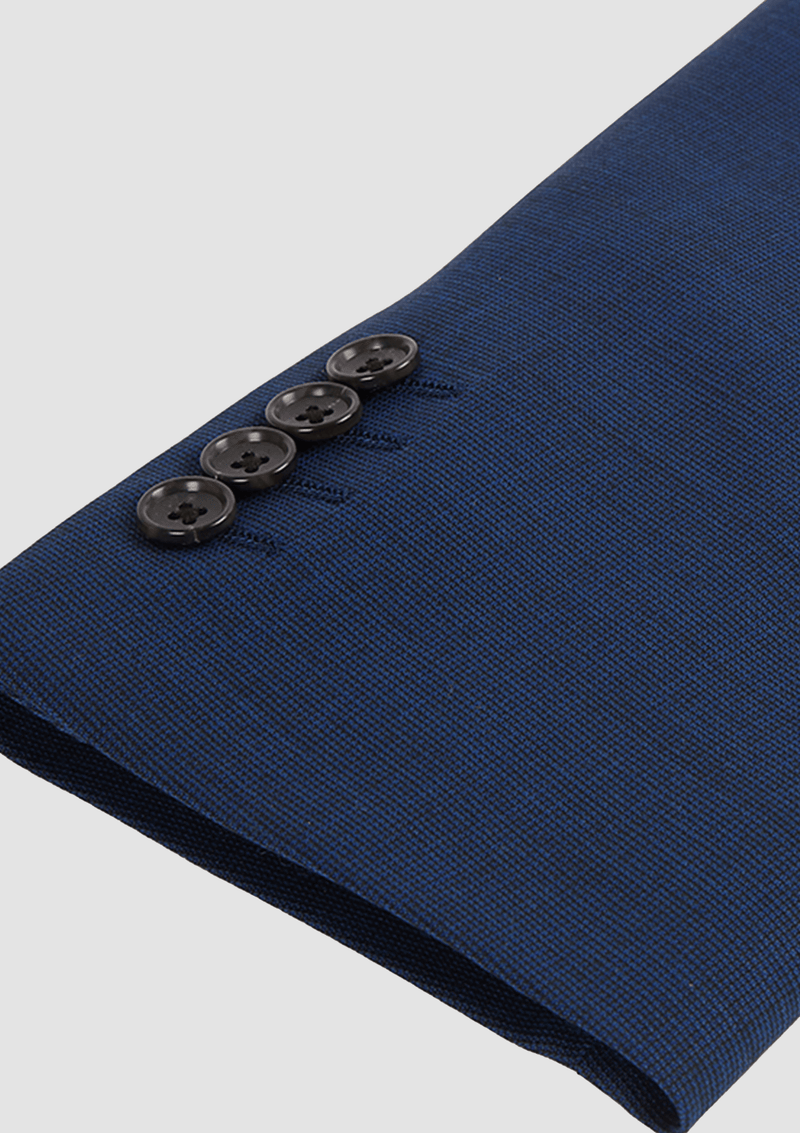 the sleeve button detail of the jeff banks slim fit performance mens business suit jacket in navy bue wool lycra blend K386021