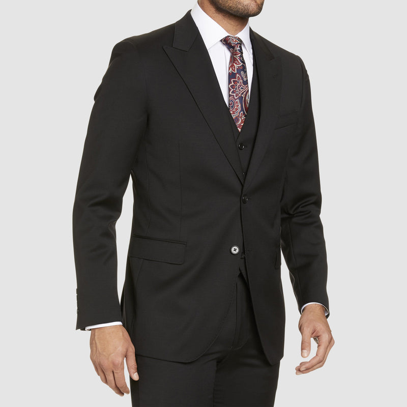the studio italia lugano suit in black merino wool ST362-31  layered with the hudson vest and white shirt underneath