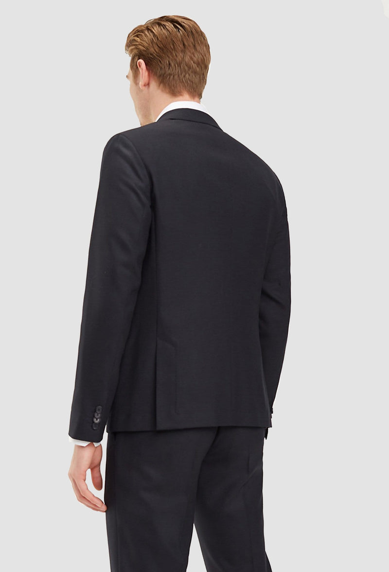 a back view of the slim fit Tommy Hilfiger virgin wool suit blazer in black