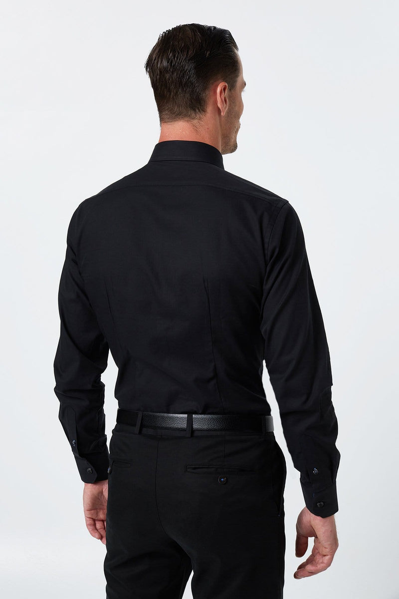 the back view of the wolf kanat slim fit romanov shirt in black twill sshowing the tapered fit and single cuff details