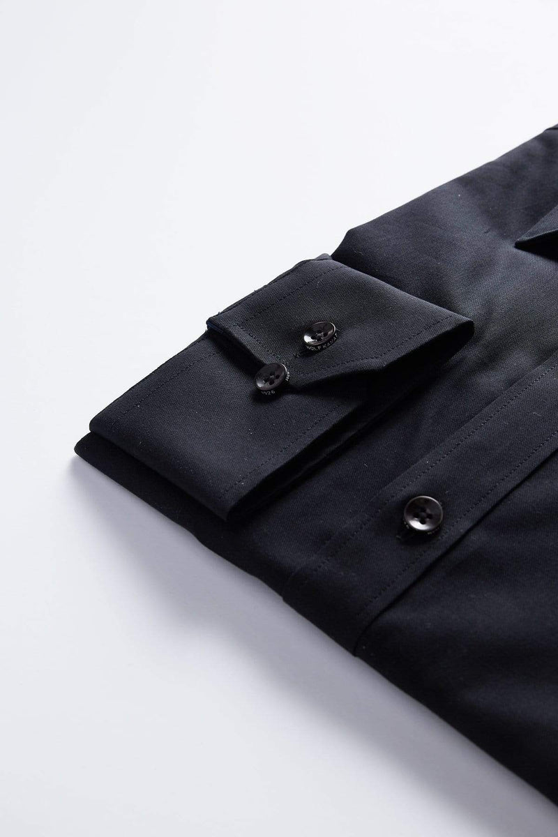 the black buttons are shown in this close up of the single cuff detail on the wolf kanat slim fit mens shirt