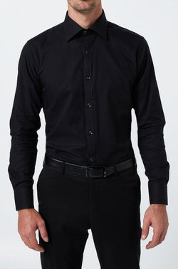 a model wears all black featuring the slim fit wolf kanat romanov shirt in black cotton twill 8WKS928