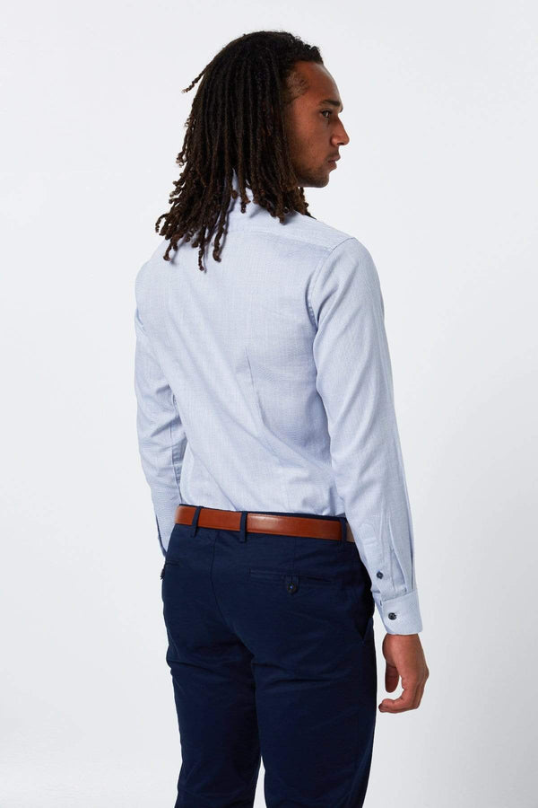 a model wears the wolf kanat business shirt in blue pure cotton with a navy trouser