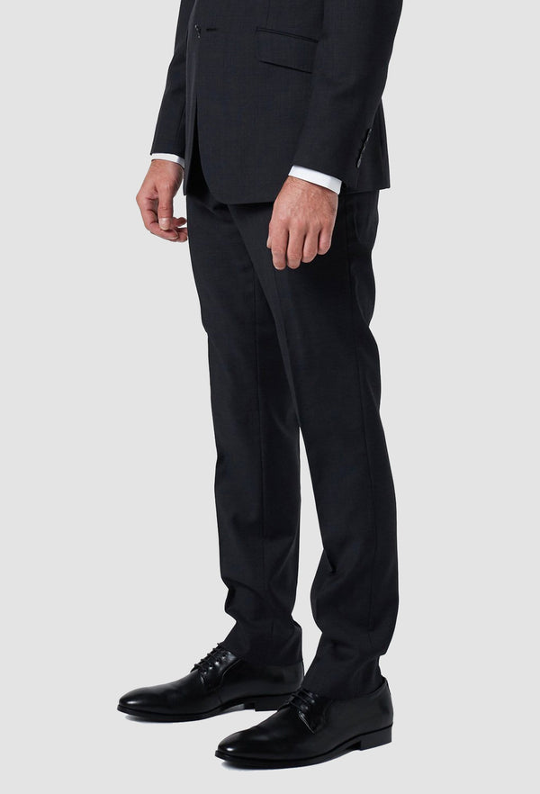 a model wears the wolf kanat slim fit hearts trouser in charcoal superfine wool 6WK8214