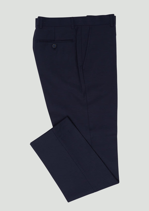 the wolf kanat slim fit spade trouser folded ona. plain background, navy wool code 7WK4238