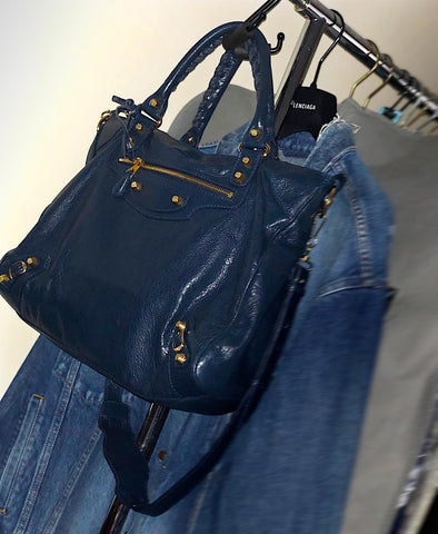 Navy Balenciaga Bag on handbag hanger