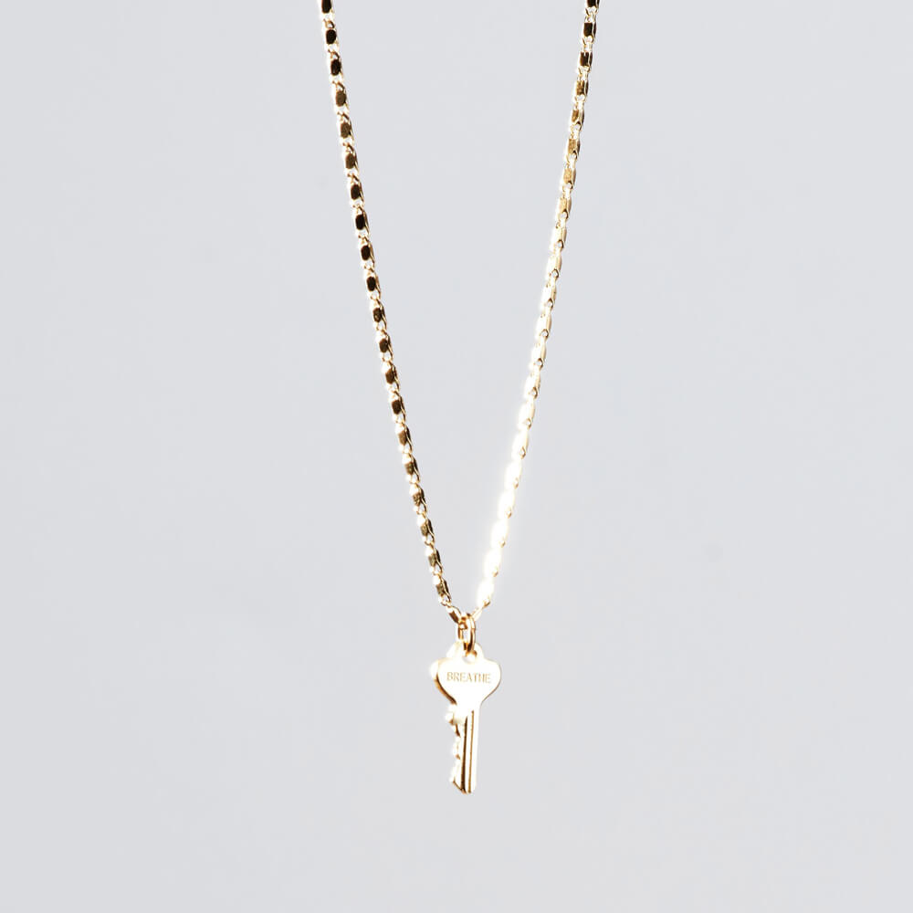 petite key necklace breathe