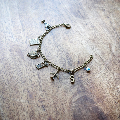 Travel charm bracelet with alphabet charm