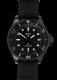 MWC 24 Jewel 1982 Pattern 300m Automatic Military Divers Watch in Black PVD with a Sapphire Crystal on a NATO Webbing Strap