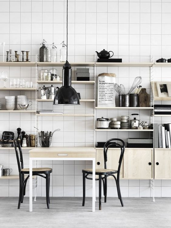 Black and white kitchen with a touch of nature