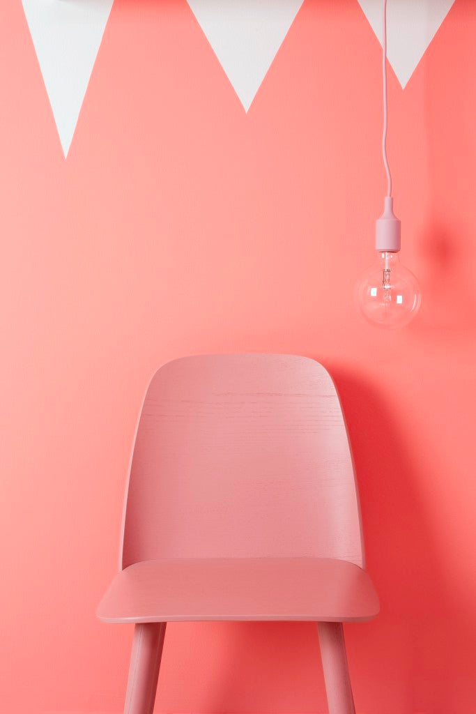 E27 pendant lamp and nerd chair from Muuto styled in a pink wall, interiors, colour trends spring 2106