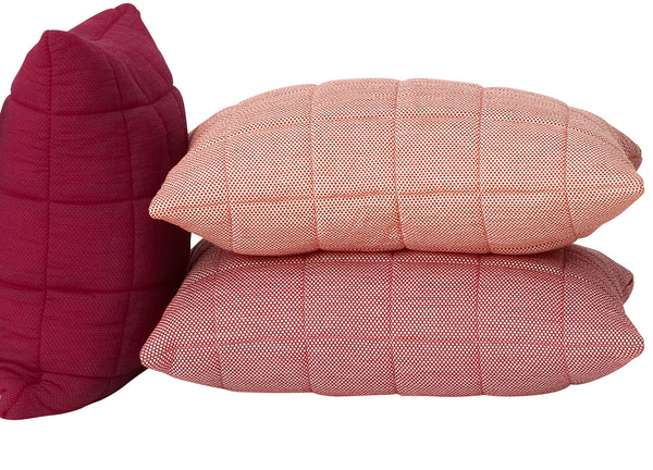 Soft grid cushions by Muuto, light red, red and tangerine,