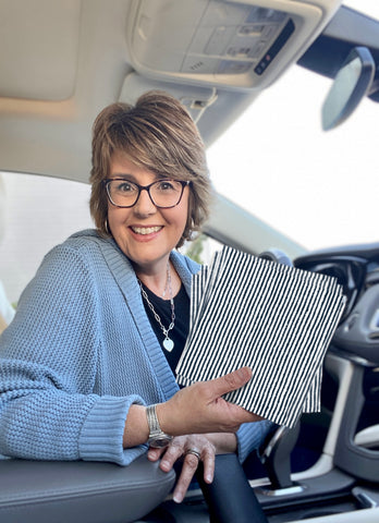Jill Bauer showing Blue Ticking NEATsheets that she keeps in her car to keep NEAT.
