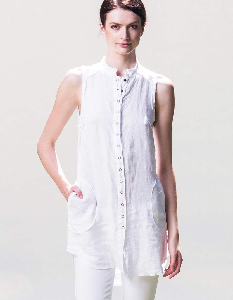 White organic linen button up shirt. Can also be worn as a shirtdress.