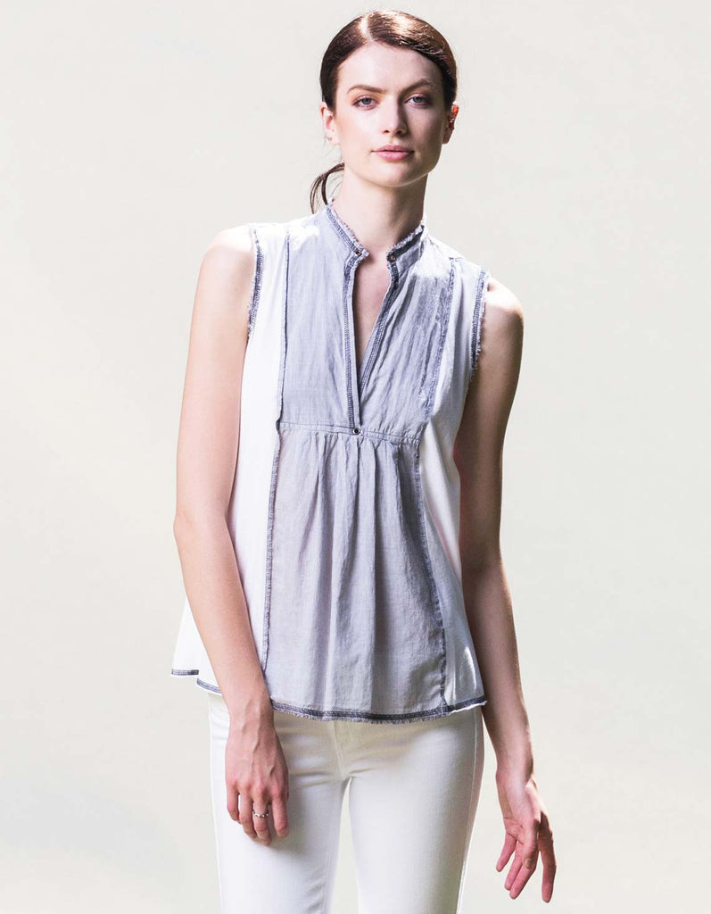 Easy white organic cotton tank top with mandarin collar and eyelid detail.