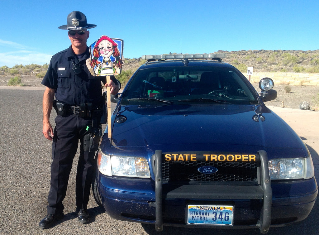 police officer holding cousin mary jane character sign