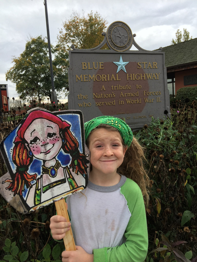little girl holding cousin mary jane character sign