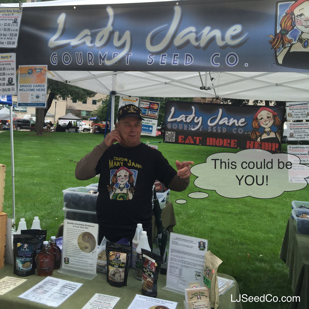 man working at Lady Jane expo booth
