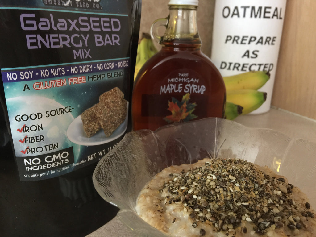 GalaxSeed energy bar mix in oatmeal with maple syrup bottle