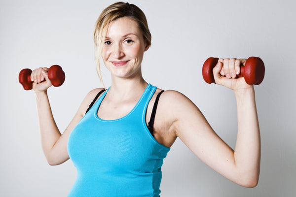 woman lifting weights for best pregnancy workouts