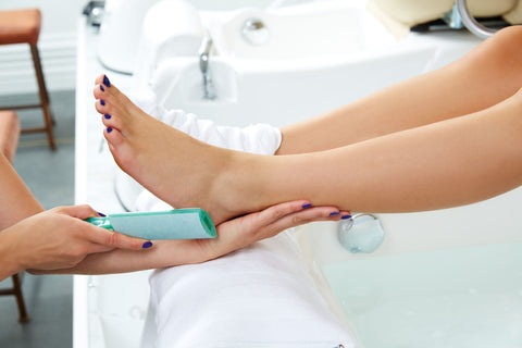 pregnant woman getting pedicure