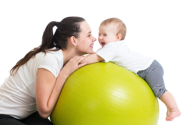 mom exercising with baby for postpartum fitness
