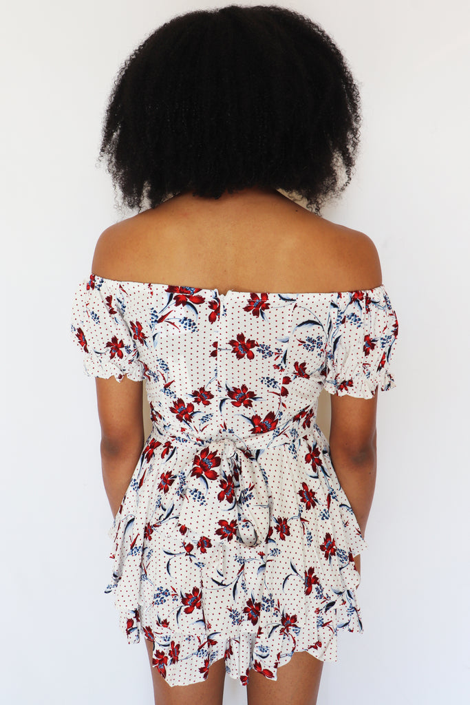 ON TOP OF THE WORLD WHITE FLORAL ROMPER
