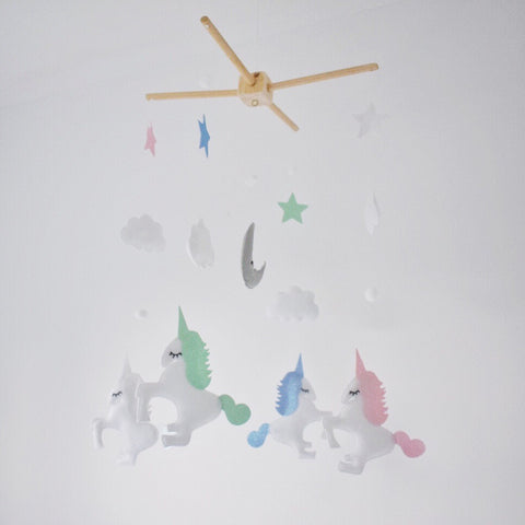 Pastel coloured Baby Unicorn mobile, with four unicorns,moon, clouds, stars and Pom poms