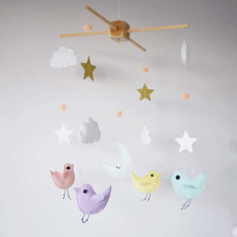 Baby mobile with four pink birds, six glitter stars, fluffy white clouds and pompoms