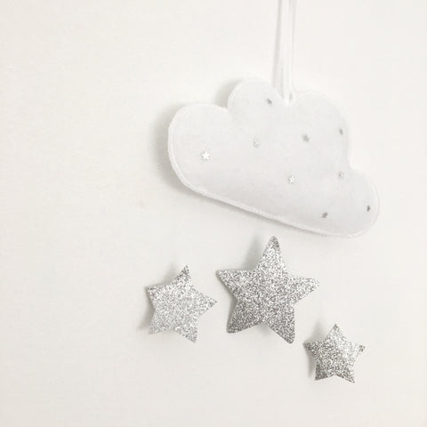 A mini cloud wall decal with silver stars and hanging glitter stars