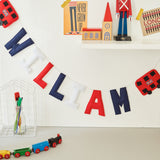 A London themed custom name bunting /garland /wall hanging, two red buses and custom name garland / bunting
