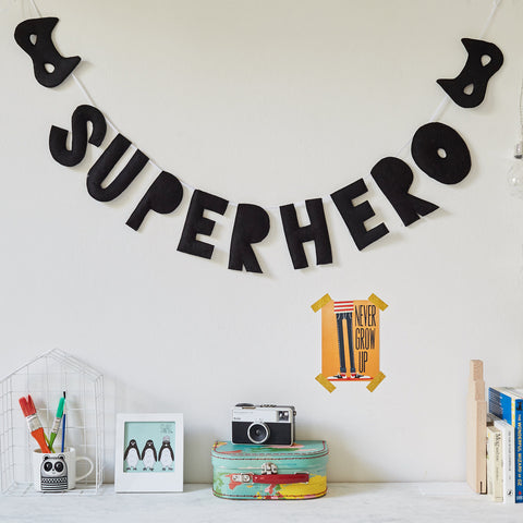 Superhero wall hanging with two masks, felt garland, bunting, monochrome