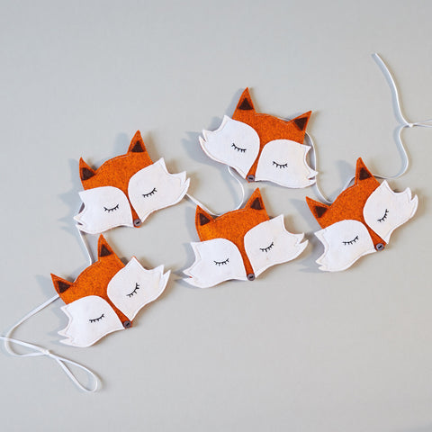 A hanging fox garland made from felt