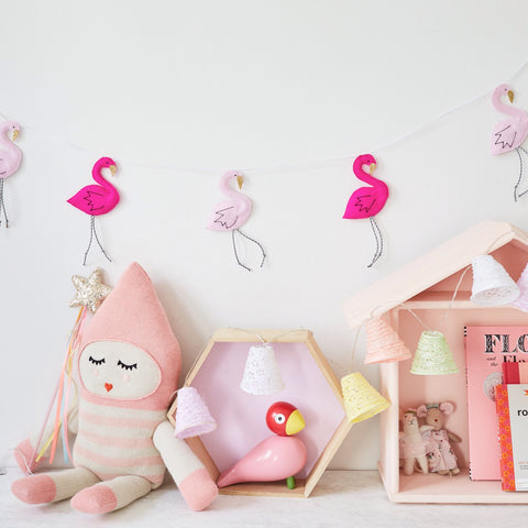 A flamingo garland made from felt