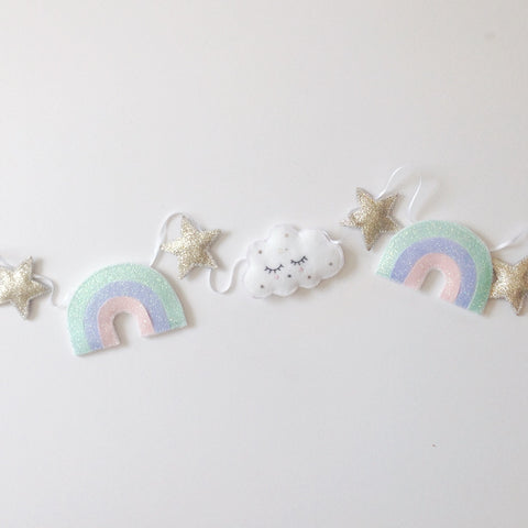 A cloud, star and glitter rainbow garland
