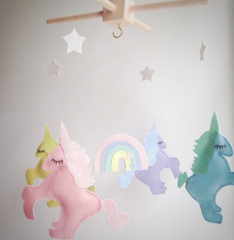 A unicorn, rainbow and star mobile
