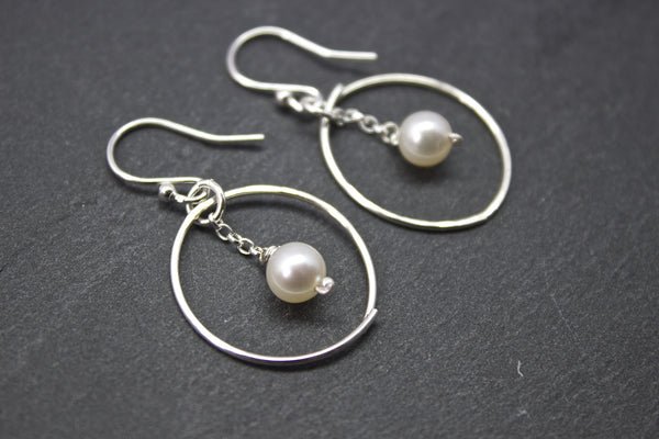 Earrings with circle and freshwater pearl drop