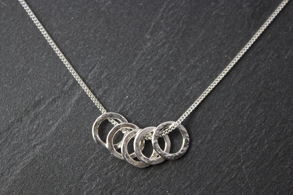 Pendant with five small circles