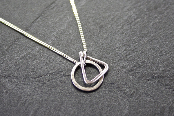 Pendant with circle and triangle