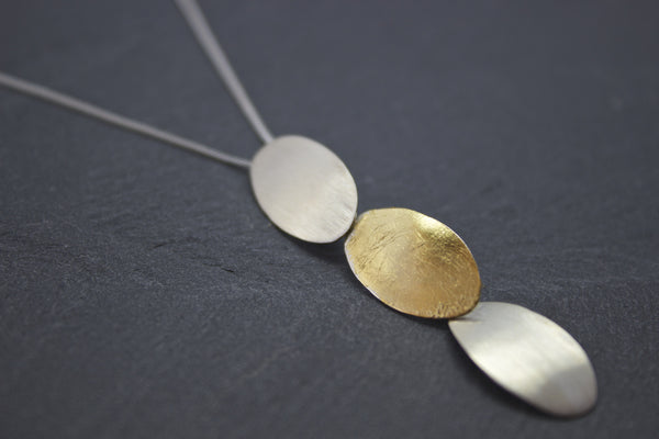 Pendant with silver and gold leaf ovals