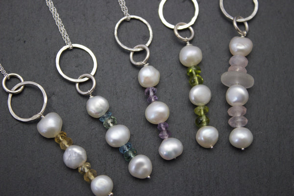 Pendant with a column of freshwater pearls and semi-precious stones.