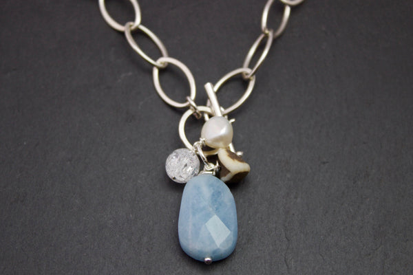 Necklace with aquamarine, rock crystal, pebble and pearl.