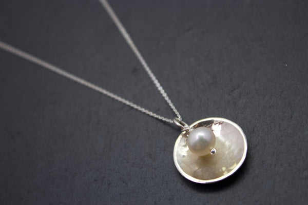 Pendant with domed disc and pearl